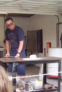 rolling molten glass in a fine glass coloring
