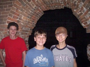 Nicholas, Travis and Austin inside a room at Ft Morgan
