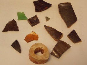Beach Finds: pottery shards, glass and a bone