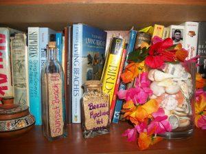 Beach sand in labeled bottles on my bookshelf
