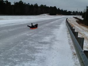 A friend's daughter ice sledding down Hwy 59 (c) Everyday IsHomeschool used with permission